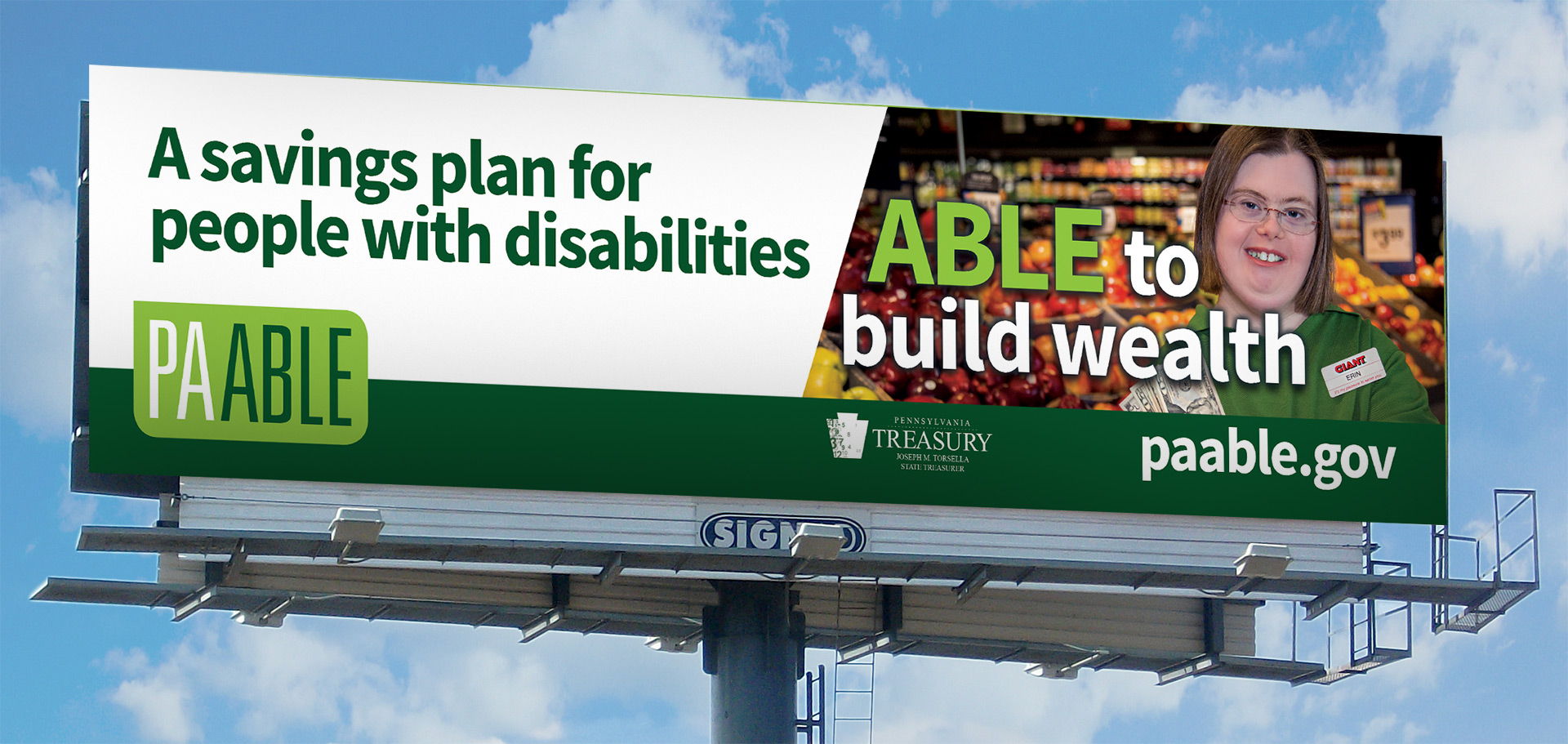 An outdoor billboard depicting PA ABLE campaign graphics