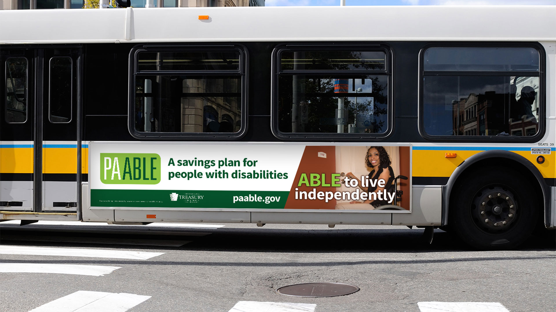 An advertisement on the side of a bus depicting PA ABLE campaign graphics